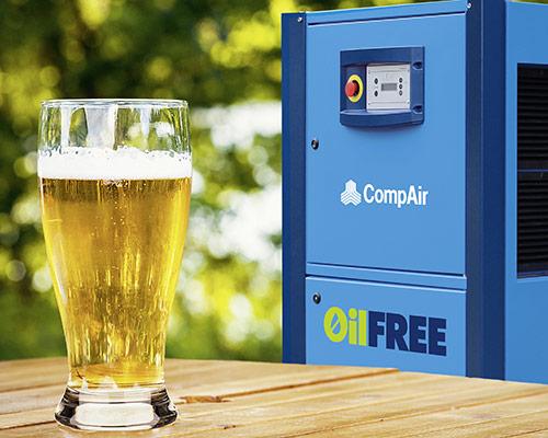 Beer in front of Compair Compressor
