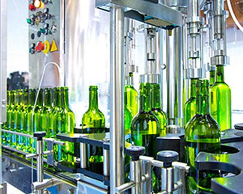 Glass bottles on conveyor